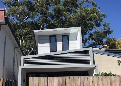 Continuous Louvre Screen with raking head | East Coast Louvres Sydney